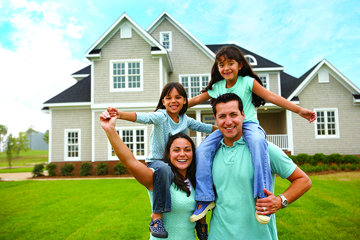 Family in front of house bank home Loan bond originator specialist bank home loans best interest rates